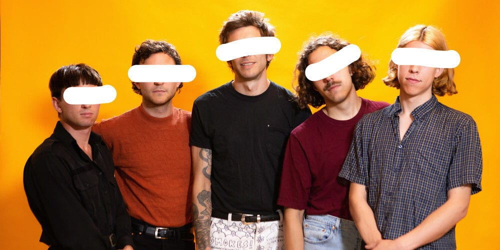 the band pottery with their eyes crossed out in white