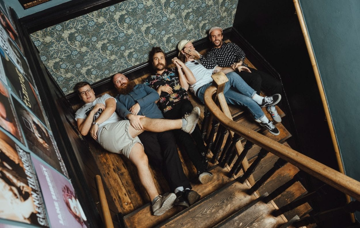 IDLES band lying on a staircase