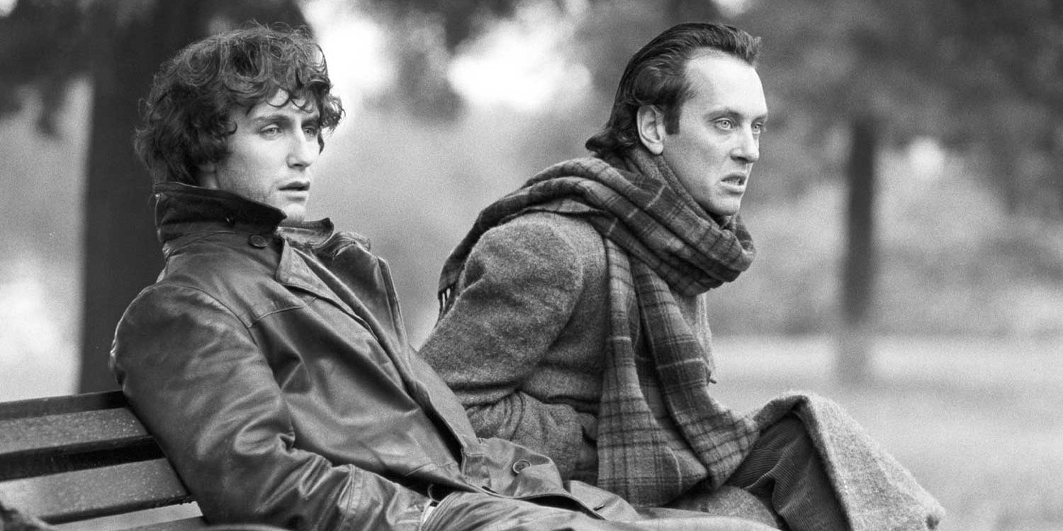 Withnail and Marwood sit on a park bench
