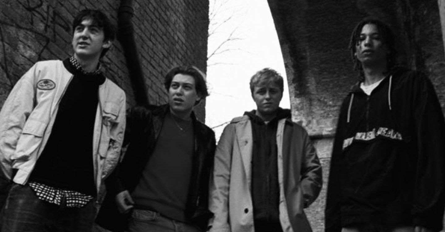 Black and white photo of the four male members of Sterling Press